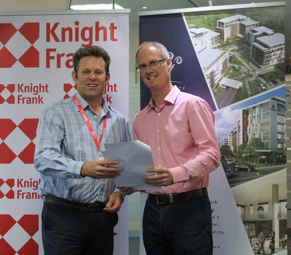 Knight Frank Kenya Managing Director Ben Woodhams and Chris Coulson, Managing Director – Garden City Development, after signing an agreement awarding the property management contract to the real estate consultancy.