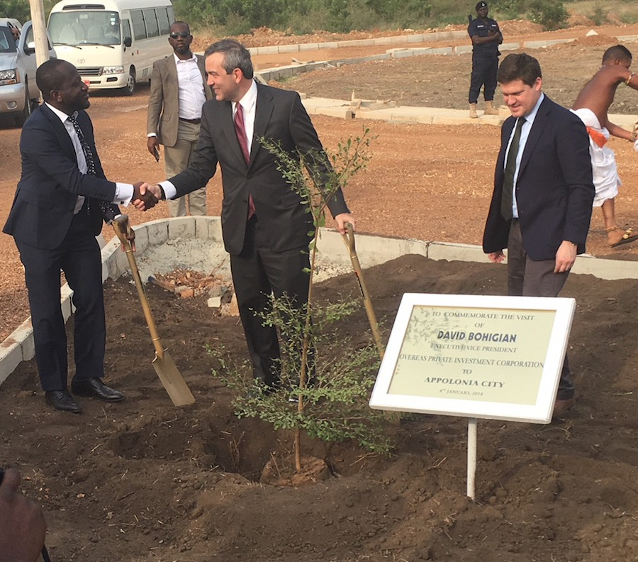 OPIC Executive Vice President David Bohigian joins OPIC client GHL Bank CEO Dominic Adu to plant a tree commemorating the construction of low income homes at Appolonia City in Ghana.